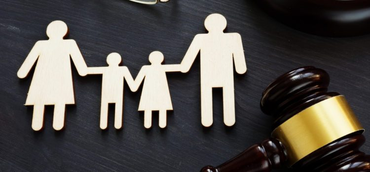 cutout of a family next to gavel